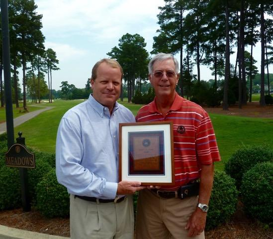 John Maeder (left) is presented with a commemorative plaque on behalf of the ASGCA.