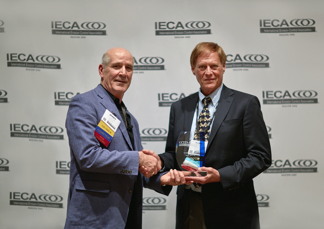 Profile's Marc S. Theisen (right) receiving the 2018 IECA Technical Paper of the Year Award.