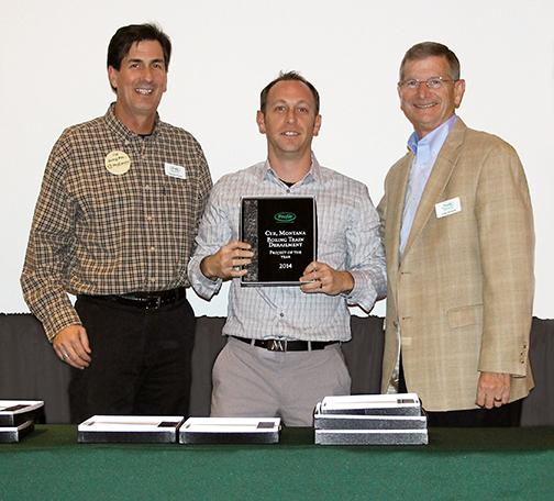 "Aaron Schmidt, of ACF West (center), receives the ""2014 Project of the Year"" award at Profile Products' annual awards banquet from Damon Sump (left), Profile Products Regional Sales Manager – Pacific NW  and John Schoch, CEO and President of Profile Products."