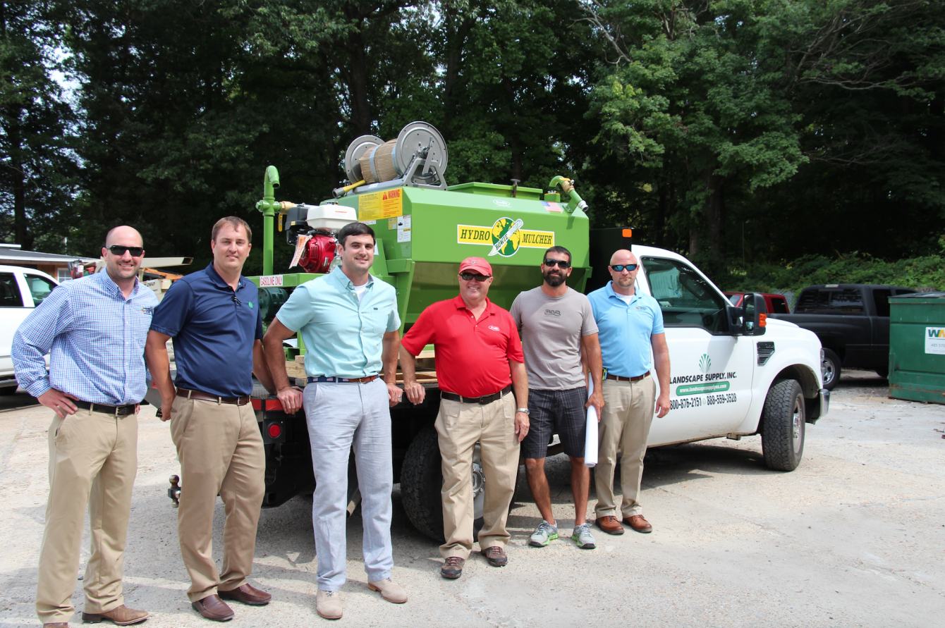 Staff of Erosion Control Services and Landscape Supply are pictured with Profile Products' Regional Sales Manager and their prize.